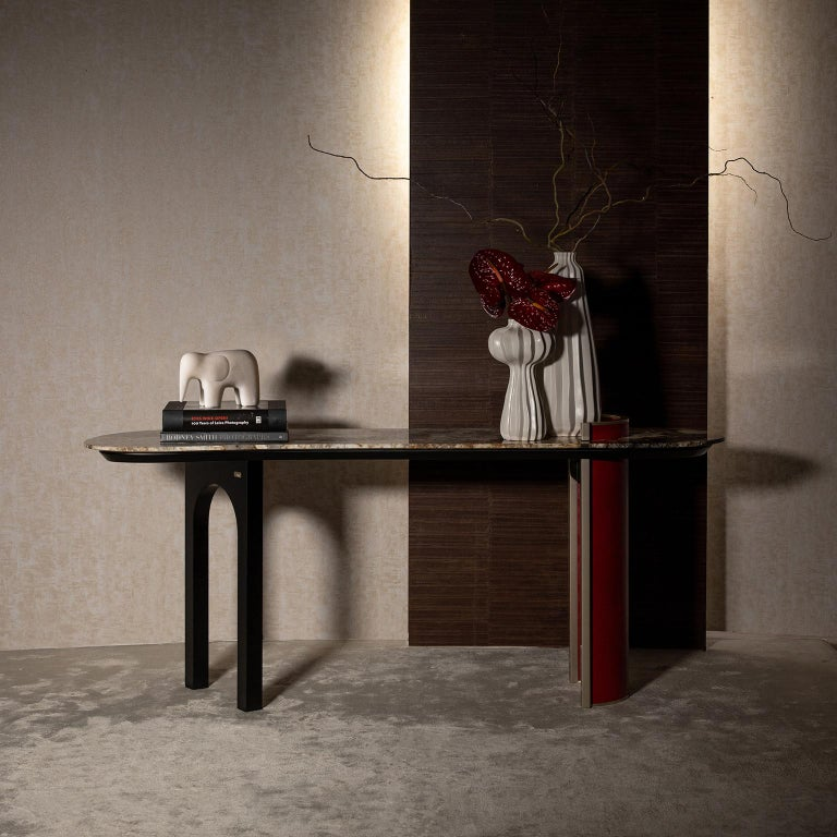 Wooden console with main structure lacquered in satin black. Tabletop in polished Patagonia granite backlit with LED light. Semicircular wooden base upholstered in dark red premium Italian leather, with top border detail in high-gloss