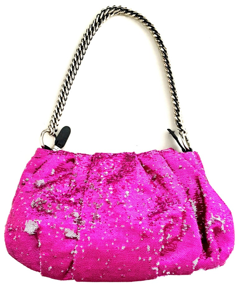 21st Century Contemporary Silver & Fuchsia Reversible Sequin Leather and Chrome Shoulder or Clutch Hand Bag By,  OR Yanny. This new and never used hand bag features a silver chrome and leather chain link removable shoulder strap, The