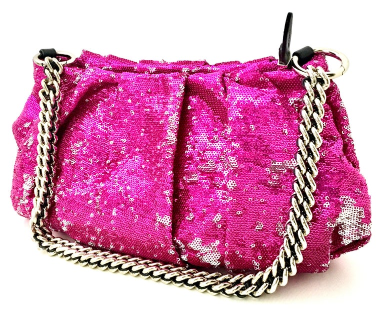 21st Century Contemporary Silver & Fuchsia Reversible Sequin Leather and Chrome Shoulder or Clutch Hand Bag By,  ORYanny. This new and never used hand bag features a silver chrome and leather chain link removable shoulder strap, The