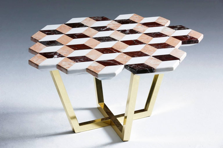 The Diplopia coffee table was conceived from the idea of creating an object that conveys an optical illusion. The stereographic effect is produced through combining different kinds of marble. The asymmetric form of the marble table top adds to the