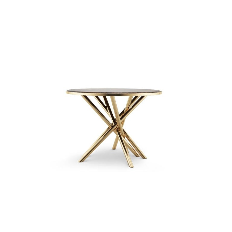 Each line naturally traced on the Duchess' Emperador marble table top tells the story of this raw material of a thousand trades, out of which ancient masters and artisans carved stonework and embellished noble monuments. The Duchess side table has a