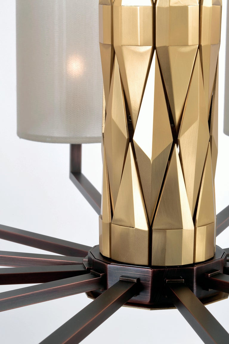 Flaire collection, rich central body composed of many solid brass elements, beveled in various ways for an array of facets.  Central structure and detailing in solid natural brass, lamp holders, base and inner structure in burnished copper finish.