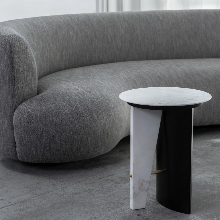 Side table in matte Calacatta Bianco marble. Wooden semicircular leg lacquered in satin black and metal hardware in dark oxidized brass with a high-gloss finish.  Foice side table  Fi007 black lacquer; satin finish St027 Calacatta Bianco
