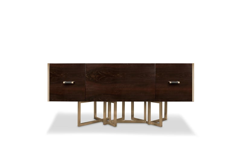 Inspired by such phenomenal building, Porustudio created Hancock modern sideboard, which its base is made in polished brass while the structure of the Hancock contemporary sideboard is made in dark oakwood and features an extremely elegant black