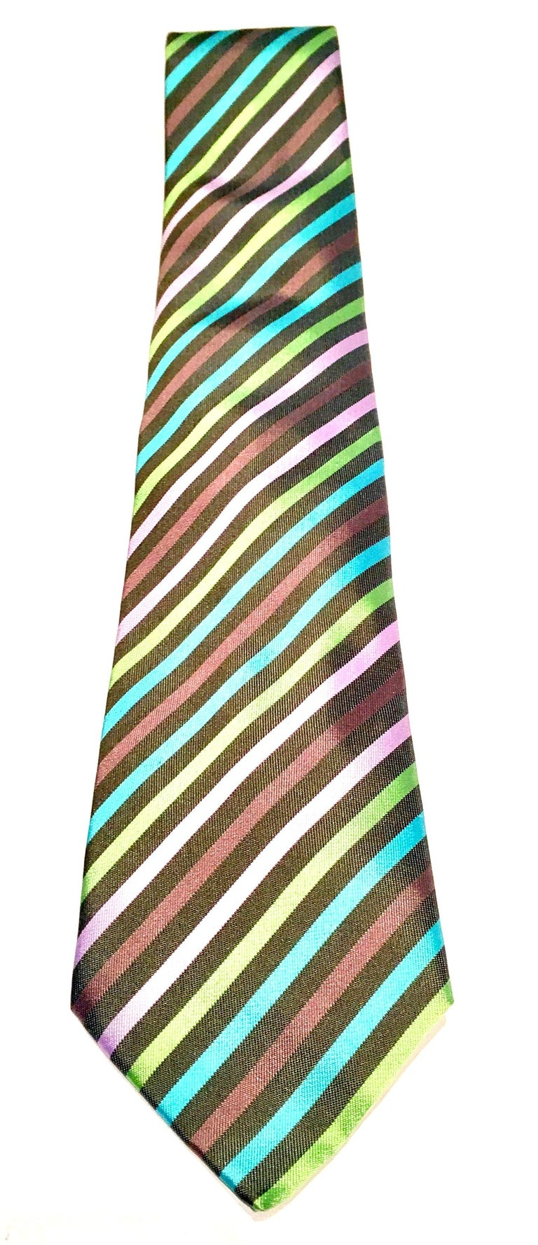 Contemporary Hermes Paris diagonal striped silk tie. Features a grey ground with pink, lime, lavender and turquoise stripes. Original authentic Hermes tags intact. Serial number reads, 758610T.