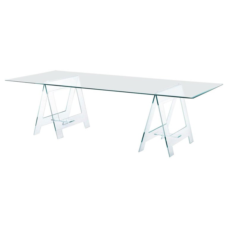 This is a very eclectic table cause it's unusual form with its top on a pair of easels made in clear crystal; it's an important table or desk but at the same time it's a very light presence in a room.