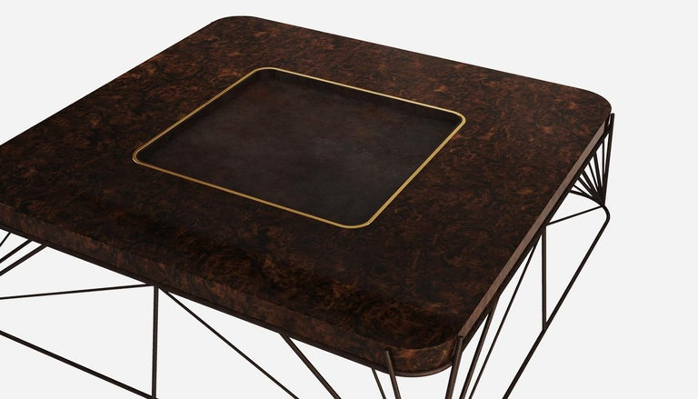 The desert utopia sculpture created by Donald inspired Porus Studio to design the Judd center table. The Mid-Century Modern table features a structure in brass with a terracotta finish, detailed with high glossed walnut wood at the center. The