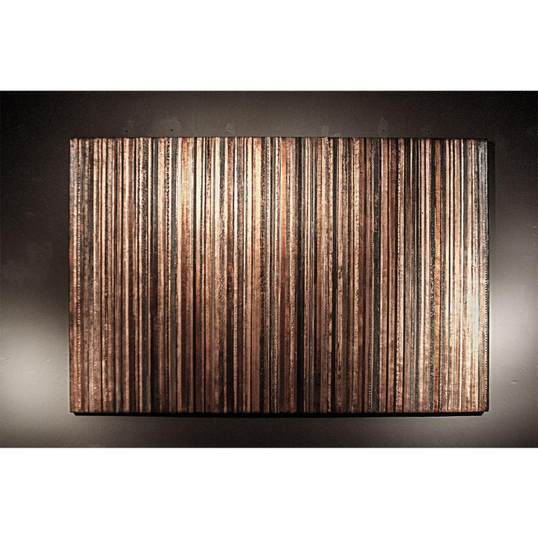 Striped artwork on canvas (230 x 150cms). Overlaid with stucco in bas relief. Painted and embellished with copper-leaf by the artist.