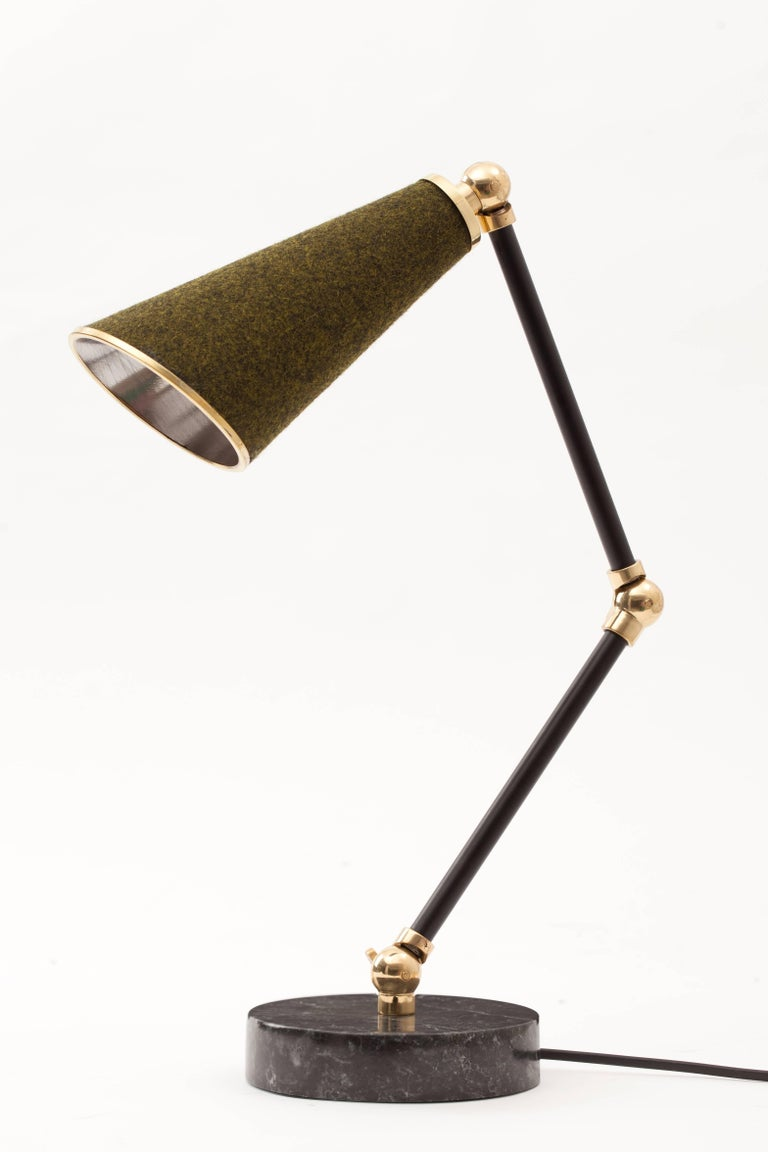 Lanterna is a new age robot lamp with a heart. Unique textured materials such as felt, cork and cowhide are combined with white and black colored marbles and shiny metals such as brass and copper. Adjustable arms of Lanterna enables users to justify