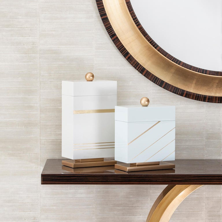 Wooden box with lid lacquered in white with high-gloss finish with details in gold leaf applied by hand. Handle and base lacquered in bronze powder-gold with high-gloss finish.  Wooden decorative box Lanzarote large  Made in Portugal.