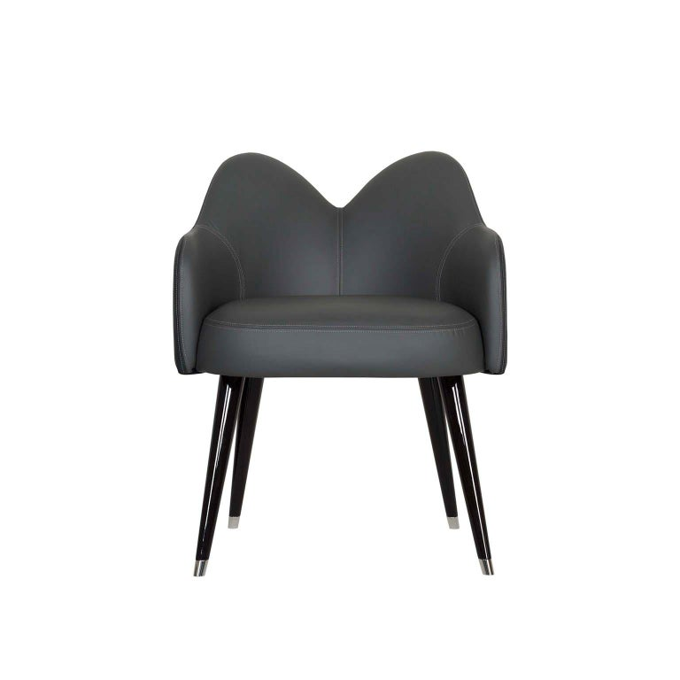 Wooden chair outer shell upholstered in grey high standard Italian leather and inner shell in black high standard Italian leather. Legs in solid beech, black stained with high-gloss finish, and end caps in polished stainless steel.