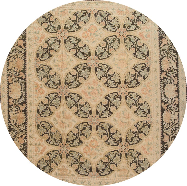 Beautiful contemporary oversize Bessarabian rug, hand knotted wool with a cream field, brown and light blue frame and accents in an allover floral design. This rug measures: 13' 2