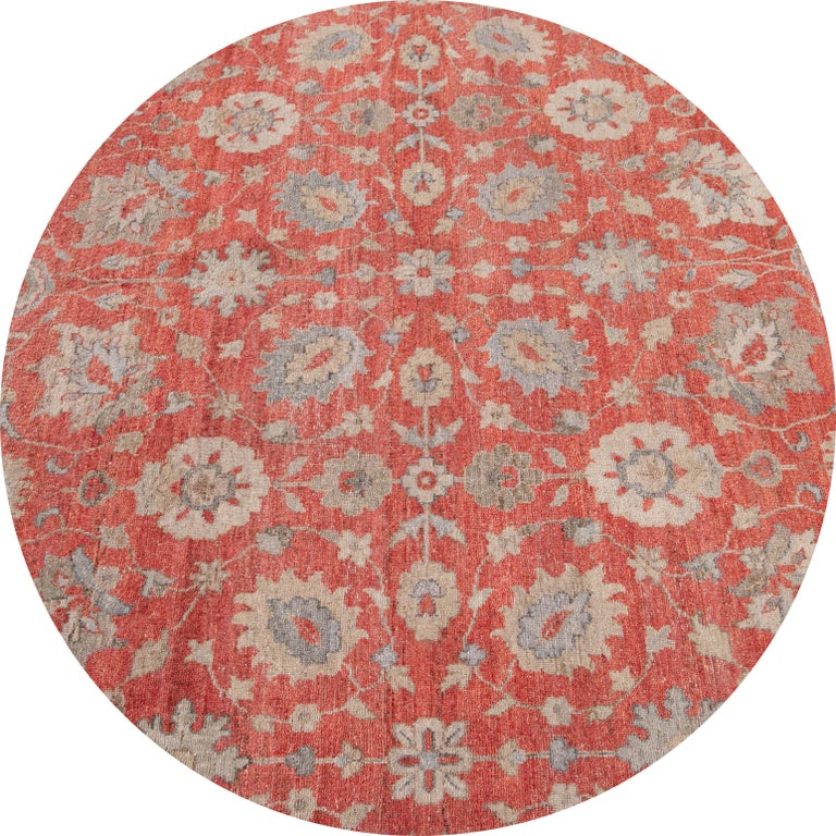 Beautiful contemporary Indian rug, hand knotted wool, with a bright red field, gray and tan accents in an all-over classic motif.