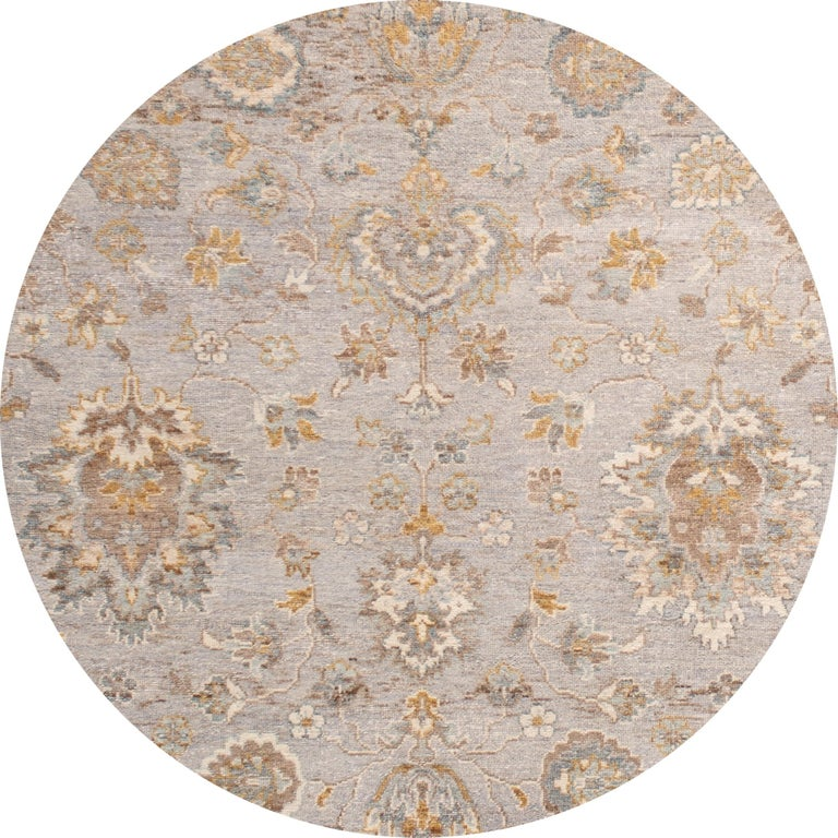Beautiful contemporary Indian rug, hand knotted wool, with a light gray field, tan and ivory accents in an all-over Classic motif, circa 2019. This rug measures 4' 2