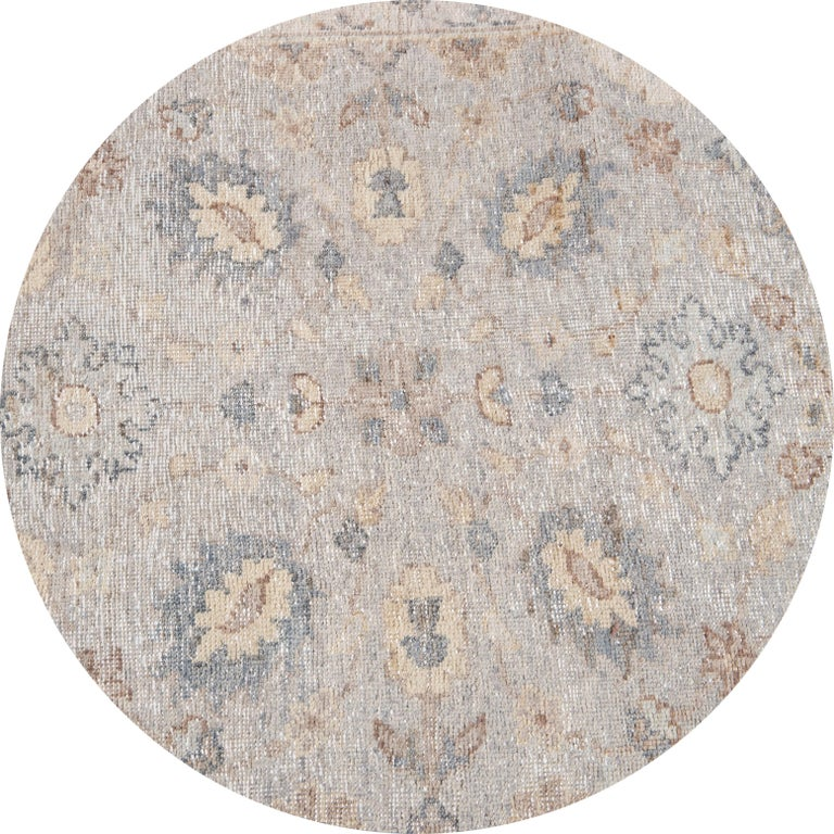 Beautiful contemporary Indian runner rug, hand knotted wool, with a light gray field, tan and blue accents in an all-over Classic motif, circa 2019.