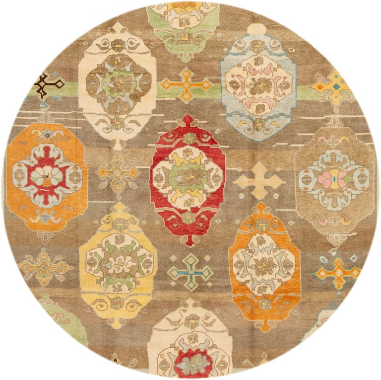 Beautiful contemporary Turkish Kars rug, hand knotted wool with a brown field, multi-color accents in an all-over the medallion design.
