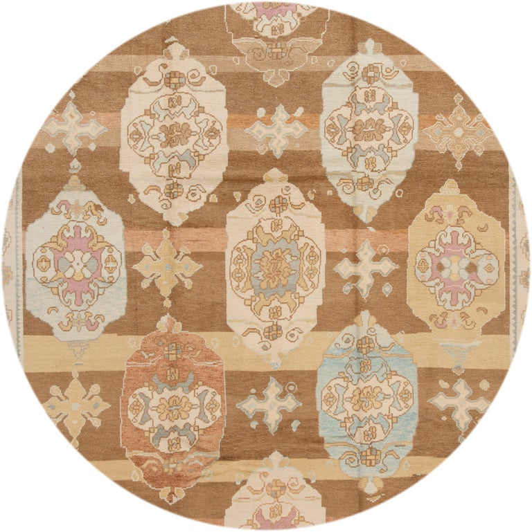 Beautiful contemporary Turkish Kars rug, hand knotted wool with an ivory frame and brown field, multi-color accents in a multi medallion design.