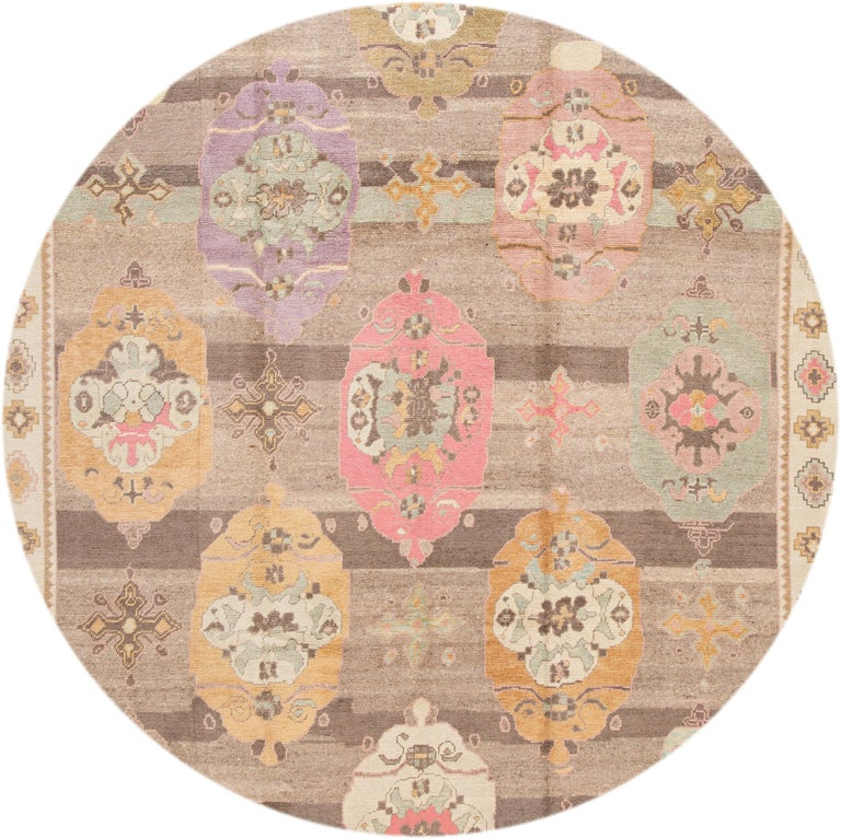 Beautiful contemporary Turkish Kars rug, hand knotted wool with a brown field, multi-color accents in a multi medallion design. This rug measures: 10'3