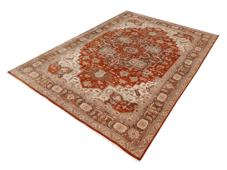 A beautiful new 21 century rug with Serapi design, hand knotted using finest Highland Wool.   Construction This artwork has a pile made of fine spun Wool. The rug is very dense and has a pile height of about 0.5 inch. Production We have a