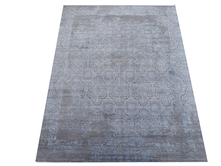 A beautiful new 21st century design carpet, hand knotted using finest highland wool and bamboo silk.  Construction This artwork has a pile made of hand spun natural dyed Wool (plant dyes). The rug is very dense and has a pile height of about 0.5