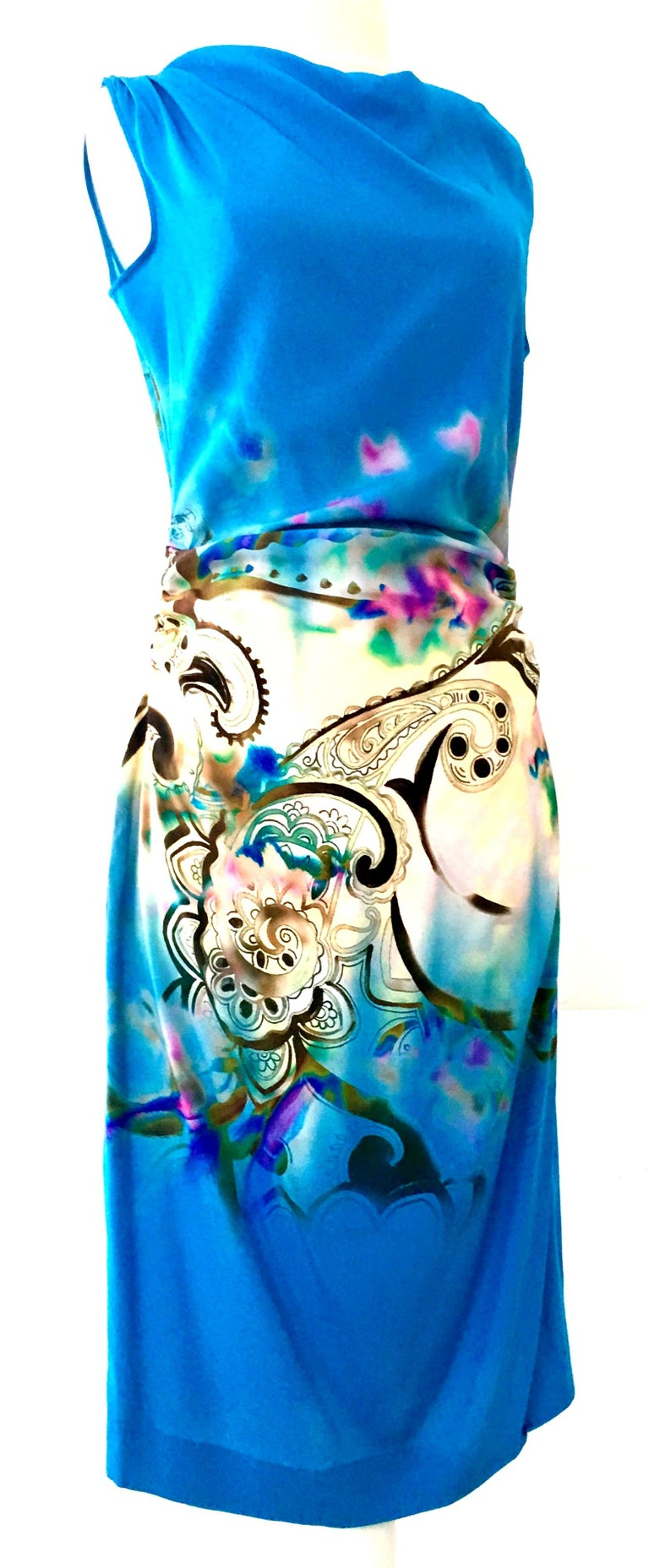 21st Century Modern & New Italian 100% Silk Print Shift Dress By, Etro. This silk turquoise with paisley and abstract print dress is new with original manufacturer and retail tags present. It features a vivid turquoise ground with a paisley and