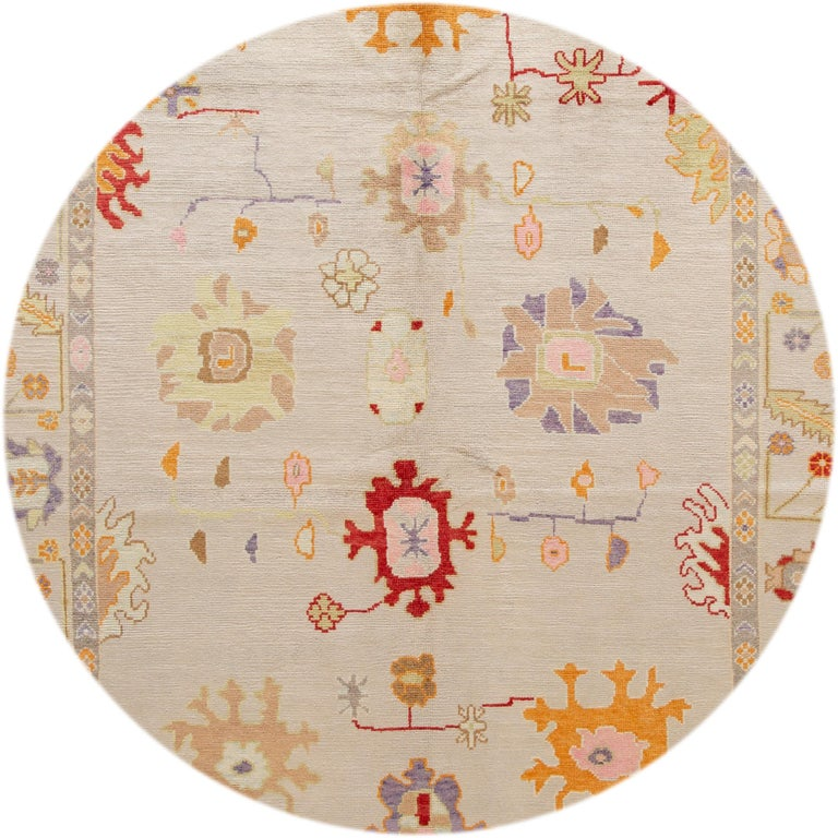 Beautiful contemporary Turkish oushak rug, hand knotted wool with a gray field, multi-color accents in a multi medallion design. This rug measures: 8'2