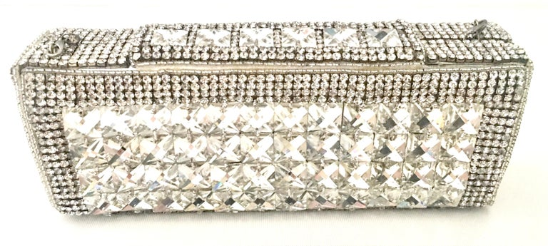 Contemporary & New Hand Crafted Silver Metallic Swarovski Crystal Clear Rhinestone Embellished Evening Bag By, Bougainvillea. This hand crafted box style hand bag features a silver metallic leather base fully encrusted with hand applied crystal