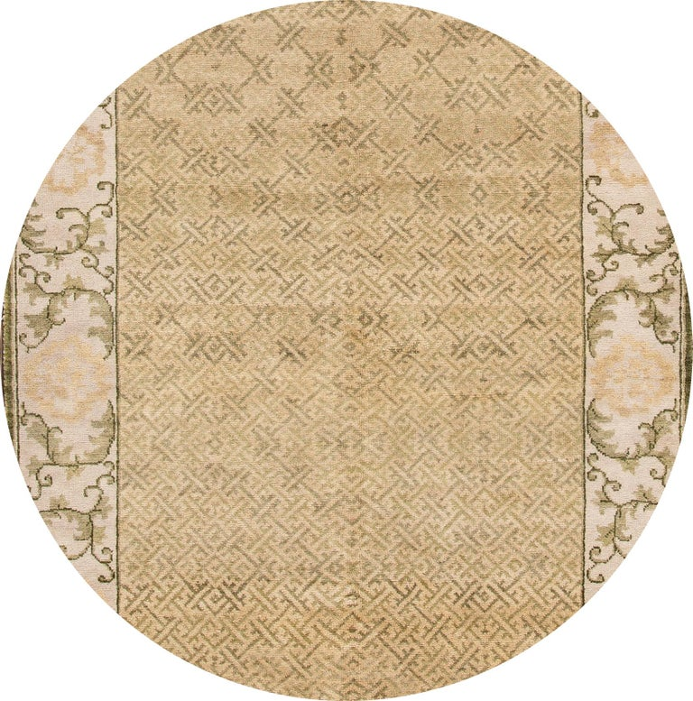 """Beautiful contemporary Spanish Sino rug, hand knotted wool with a tan field, beige frame, green and dark brown accents in an all-over geometric design. This rug measures: 5'8"""" x 9'."""