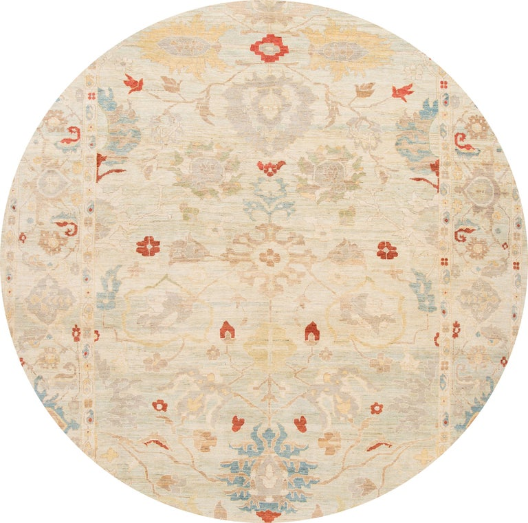 Beautiful contemporary Sultanabad Oversize rug, hand knotted wool with an ivory field, tan, blue and red accents in an all-over design. This rug measures 12' x 18' 6