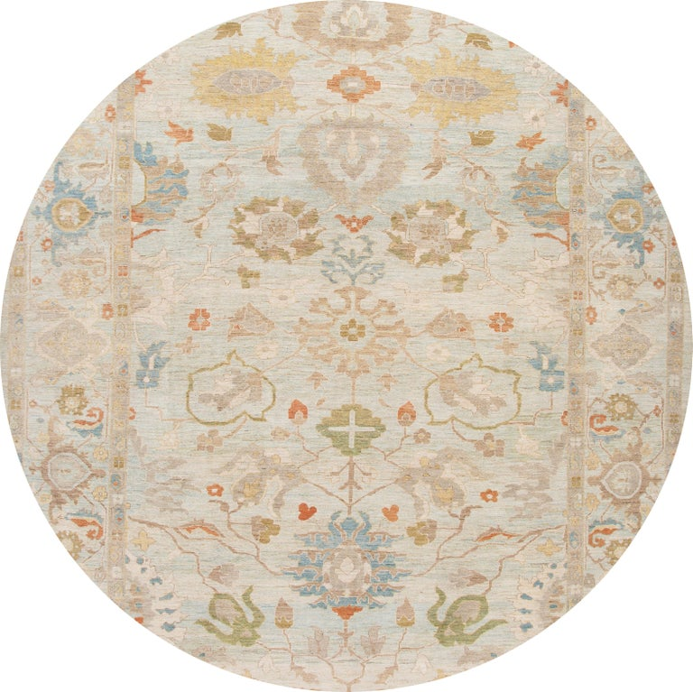 Beautiful contemporary Persian Sultanabad oversize rug, hand knotted wool with a light blue field, tan and ivory accents in an all-over design.
