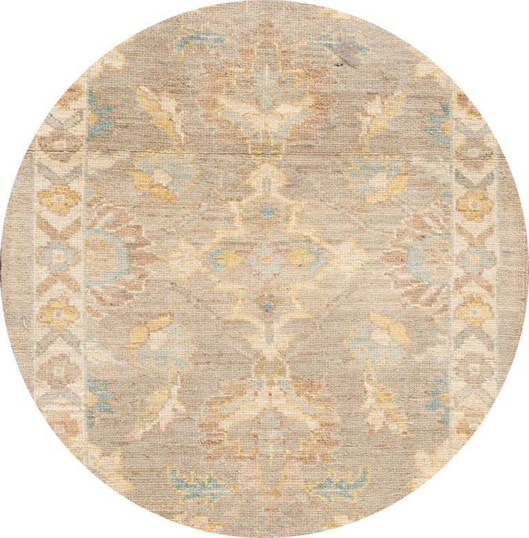 Beautiful contemporary Sultanabad runner rug, hand knotted wool with a tan field and multi-color accents all-over the design. This rug measures: 3'01
