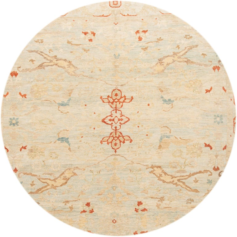 Beautiful contemporary Sultanabad rug, hand knotted wool with a light blue and ivory field, tan and red accents in an all-over design.
