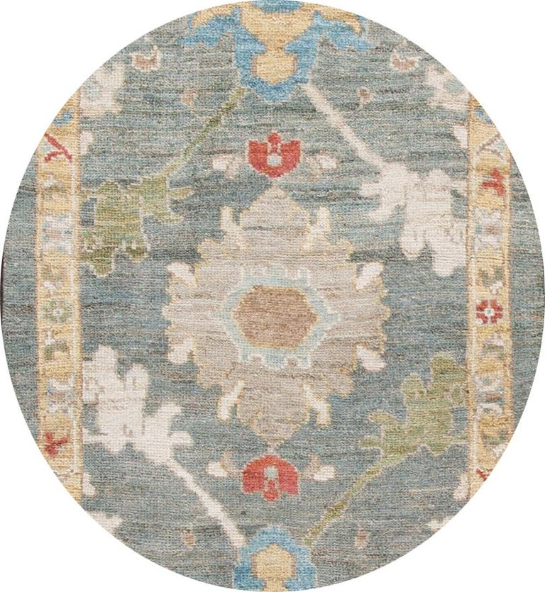 Beautiful contemporary Sultanabad runner, hand knotted wool with a green field, goldenrod, blue, and red accents in all-over Classic floral medallion design.