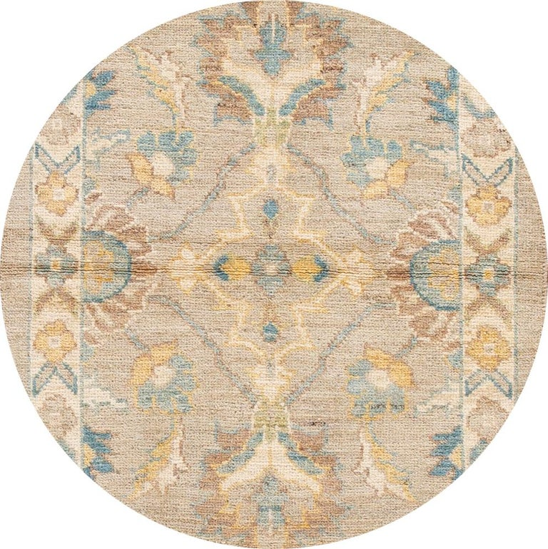 Beautiful contemporary Sultanabad runner rug, hand knotted wool with a tan field, blue, yellow and ivory accents all-over the design. This rug measures 2' 10