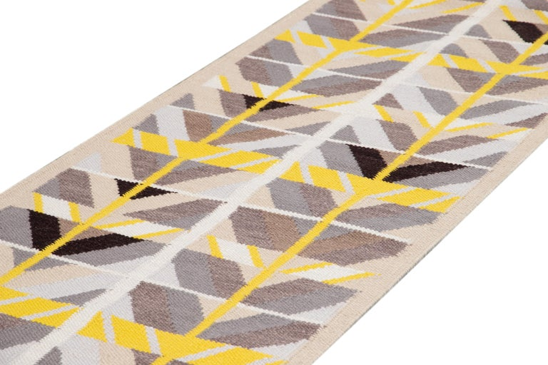 Beautiful contemporary Swedish style runner rug, hand knotted wool with a cream tan field, bright yellow and gray accents in an all-over classic Scandinavian geometric design. This rug measures 3' 1
