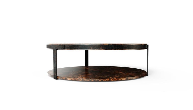 This unique place inspired Porus Studio to create Monticello modern center table. The top of this contemporary center table is made in high gloss walnut wood root, surrounded by brass with terracotta finish. This structure extends along four elegant
