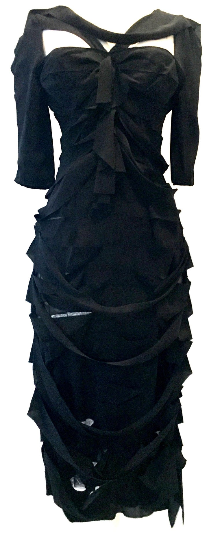 21st Century & New French Silk Black Dress By, Nina Ricci Paris - Size 6. This finely crafted architectural creation of a