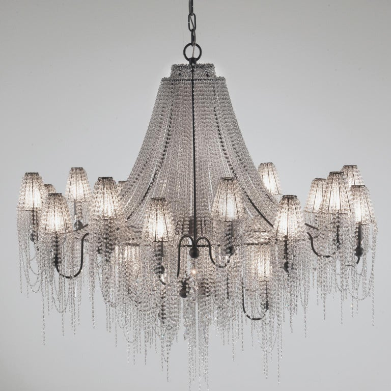 Burlesque's sister in style, the on the rocks lamps are both strong and romantic. The two models share between them that huge amount of crystals that, in a Cascade fashion, cover almost entirely the structure, leaving only a glimpse of it to be