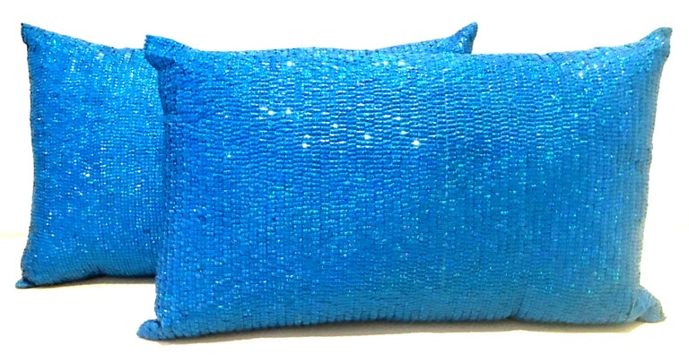 21st Century Pair of new electric blue Austrian crystal and silk down fill pillows. These lovely rectangular pillows include cotton down filled inserts, hidden zipper on the back side for easy removal. Dry clean only. New, used for display only.