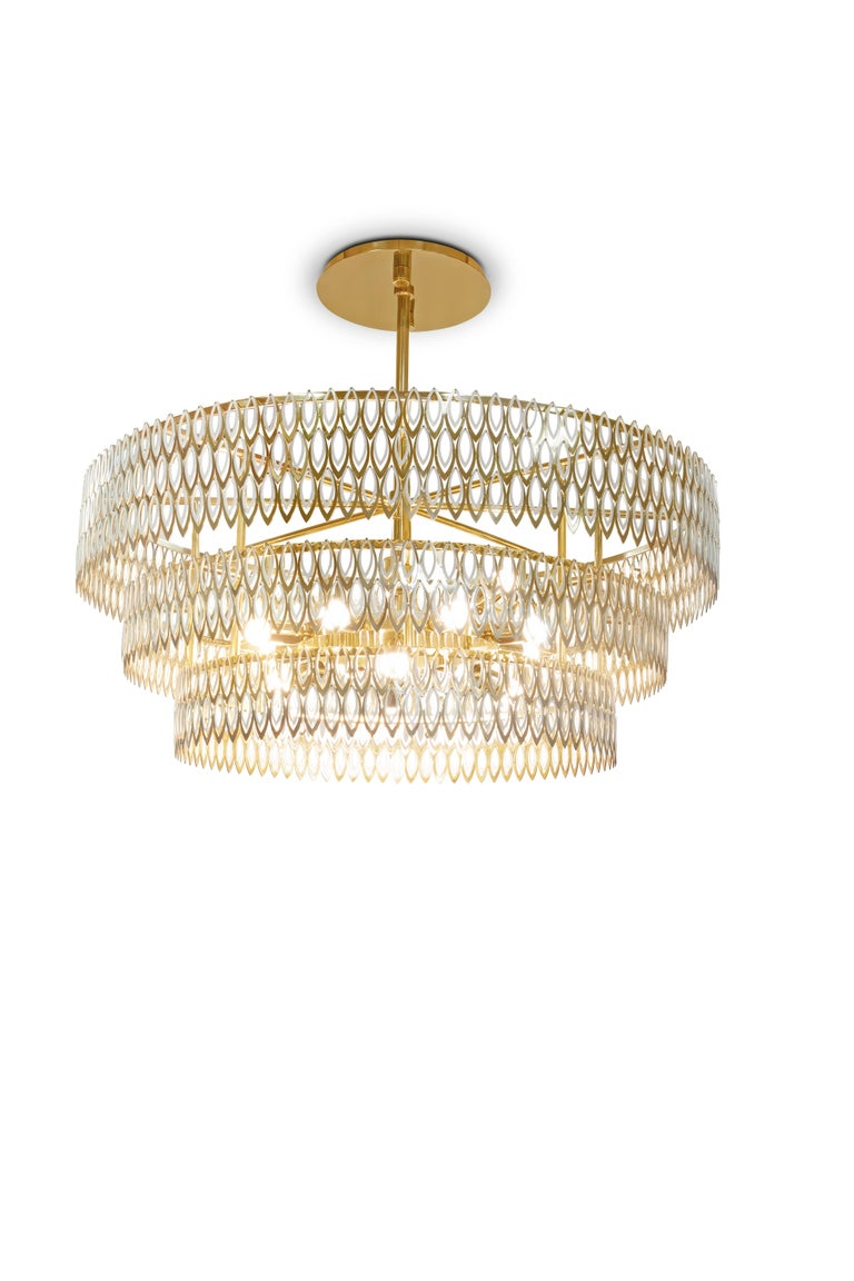 Petal is a modern chandelier which brings to any interior design set a luxurious presence. Its 3 imposing tiers of petal-shaped brass rings, finished with a rhythmic combination of of lacquered stainless steel with brass varnish finish, reflects the