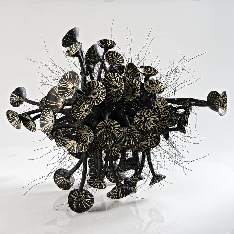Contemporary sculpture by Ursula Commandeur. Blackclay . Organic design.  Unique piece (2019)  White gold, as porcelain is also called with admiration, has always had a mysterious halo, brought to Europe in the time of MarCo Polo, porcelain