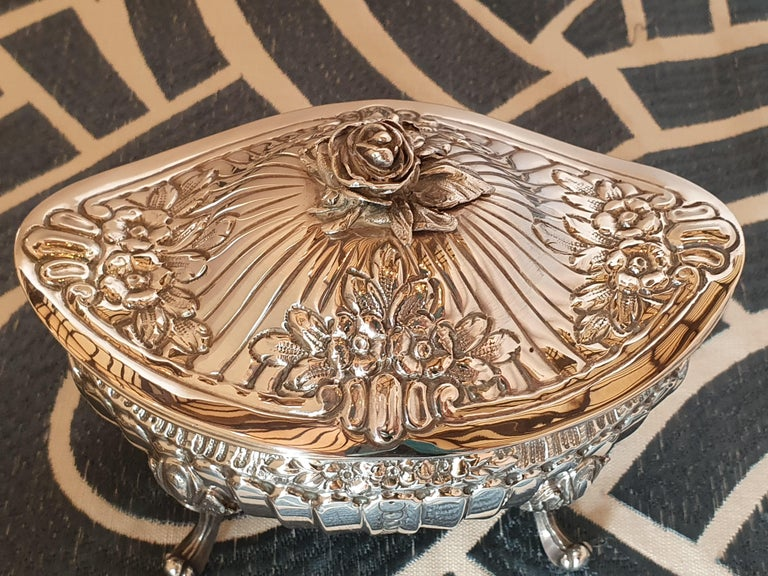 A stunning handmade sterling silver sugar box. Beautiful chisel work reproducing the Classic shape of the 18th century Turin sugar box, the knob represents a rose in an extremely realistic way. A significant example of the skill of the Italian