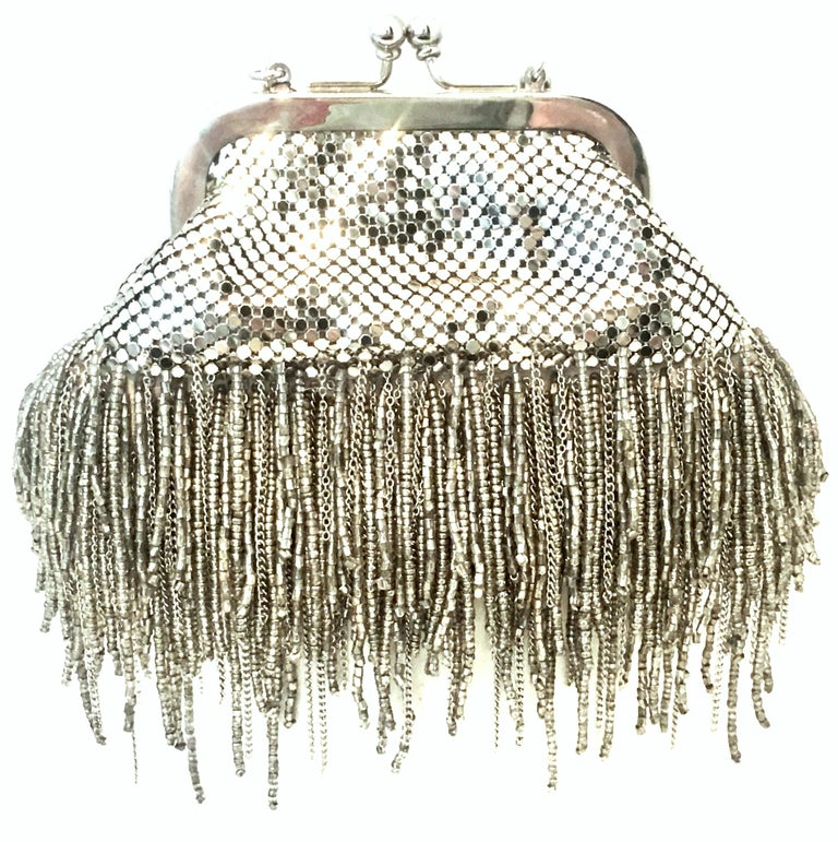 21st Century Silver Metal Mesh & Beaded Fringe Evening Bag By, Whiting & Davis. This new silver plate metal mesh with cut steel beaded fringe evening bag maintains the original manufacture tag. This soft side multi purpose piece features the iconic