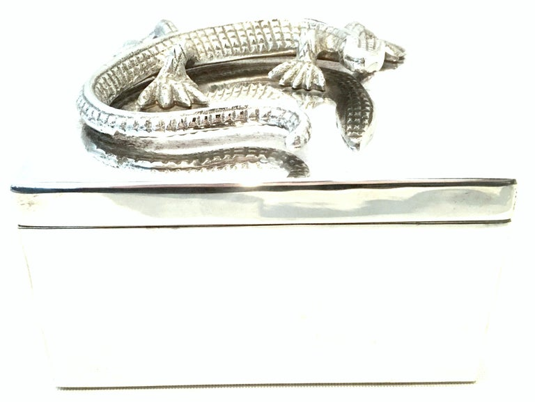 21st century silver plate lizard box. This silver plate two-piece lidded box features a sculptural and applied lizard form at the top of the lid. The size of lizard is approximately, 6