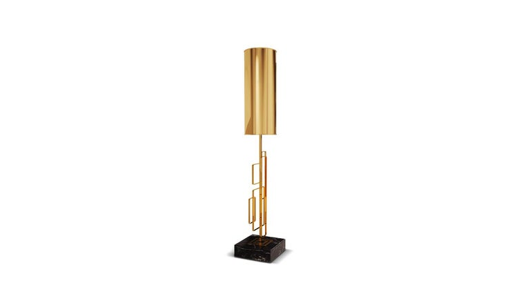The Skyscraper contemporary table lamp is supported by three geometric structures in polished brass while the body is formed with the combination of the beautiful Spaniard Negro marquina marble with polished brass. This structure is the key point of