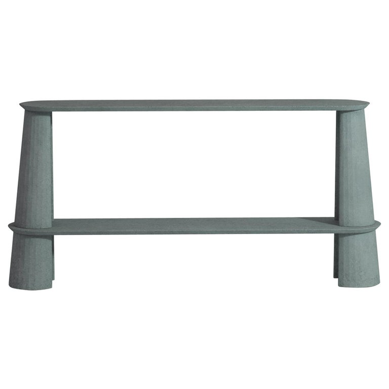 Console table part of a collection of modular system in ultra high performing cement mortar. UHPC shelves and abutment colored in the mixture and sandblasted. Available in eight different colors: Brick, silver, powder, cream, fir, dark, chocolate,