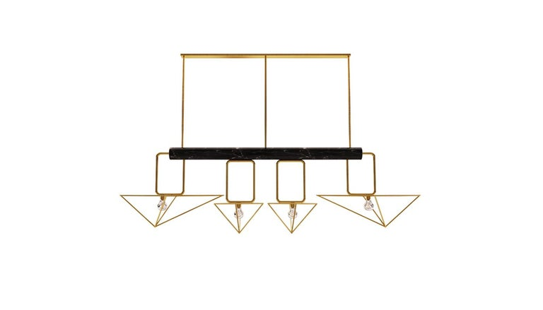 White House modern suspension lamp features a long Negro Marquina marble tube holding 4 geometric brushed brass shades of different sizes. The White House contemporary lighting piece is a different yet stylish way to decorate any modern living space.