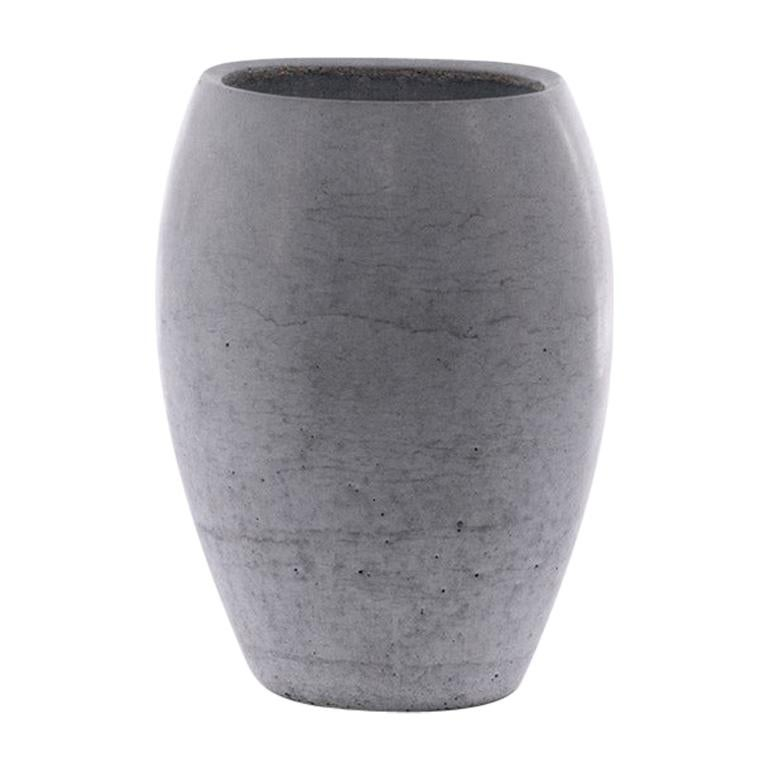 The Zazen line combines organic shapes with the texture of concrete, giving life to a family of four highly recognizable vases. Each vase is produced from a monolithic concrete casting. The design of Zazen makes it possible to reduce thickness to a