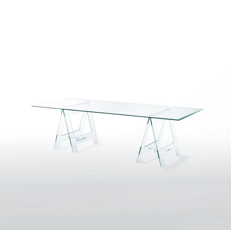 This is a very eclectic table cause it's unusual form with its top on a pair of easels made in clear crystal, it's an important table or desk but at the same time it's a very light presence in a room.