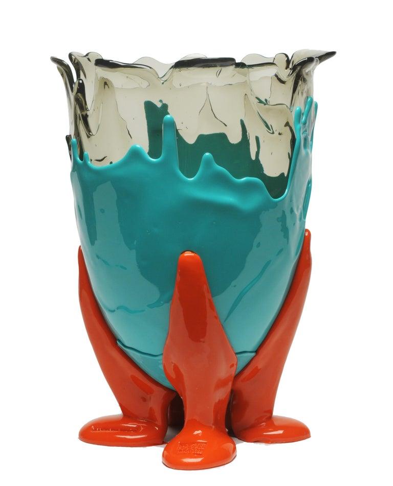Clear extra colour vase - clearaqua, matt turquoise, matt orange.  Vase in soft resin designed by Gaetano Pesce in 1995 for Fish Design collection.  Measures: M -Ø 16cm x H 26cm Colours: clearaqua, matt turquoise, matt orange. Other sizes